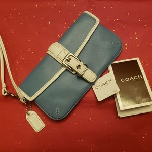 Coach leather wristlet. Blue/white .new